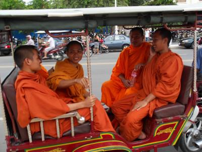 Monks in rickshaw