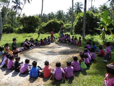 Seated children at the Care project