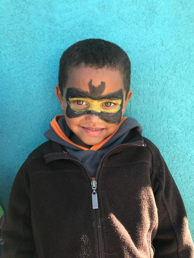 A young boy with his face painted