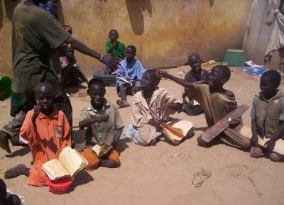 Talibé children studying