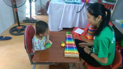 Rowena working with a patient in Vietnam