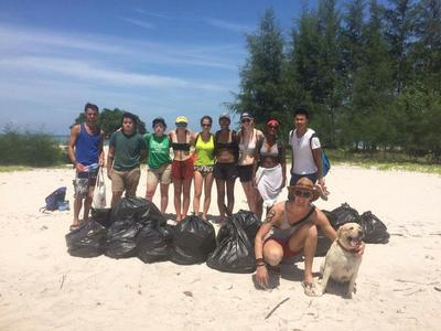 Volunteers with the rubbish collected during a beach clean-up
