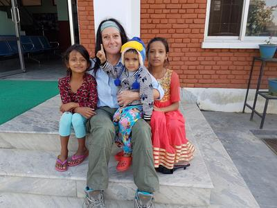 Sharon with her host familys children