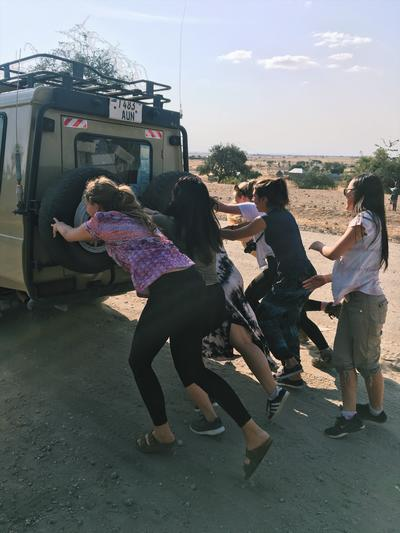 Volunteers pushing their safari truck