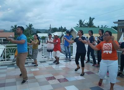 Volunteers and locals do Zumba at the Projects Abroad office in the Philippines