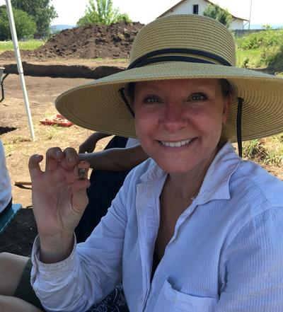 Tami shows what she excavated at a dig site