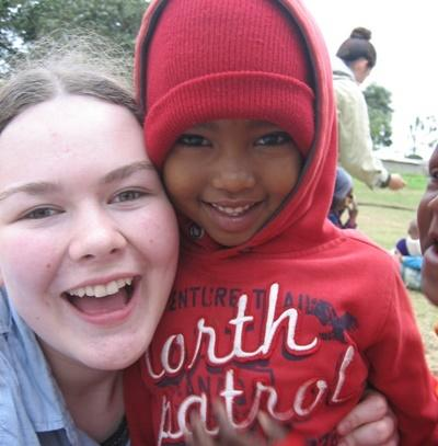 Volunteer with a young child from the Care project.