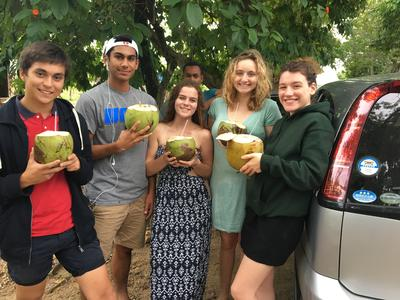 Volunteers drinking from coconuts during their free time