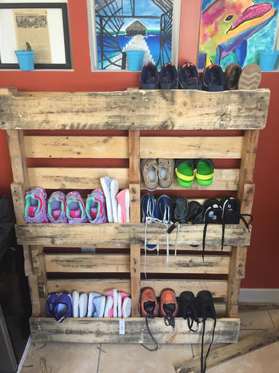 Shoe rack with donated shoes for local children