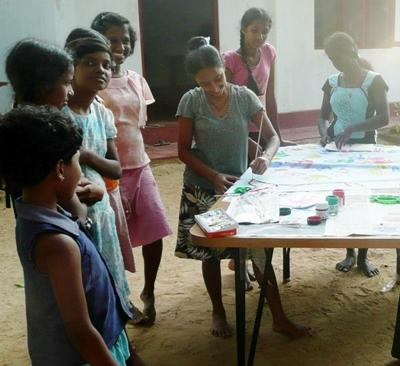 Painting with the students