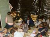 Teaching in a classroom with plastic lined walls