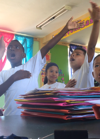 Students singing in the classroom