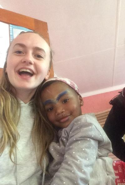 Alice spending time with a child in South Africa