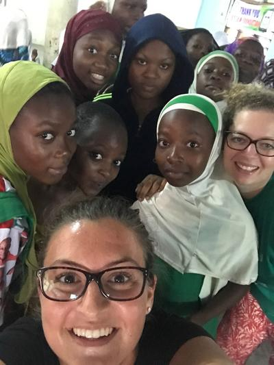 Volunteers pose with local girls in Ghana