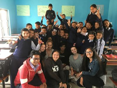 High School Special volunteers spending time with the children at a local school
