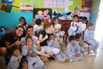 Volunteers and children at a local school in Ecuador