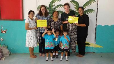 Care volunteers with the teachers and children at a day care centre