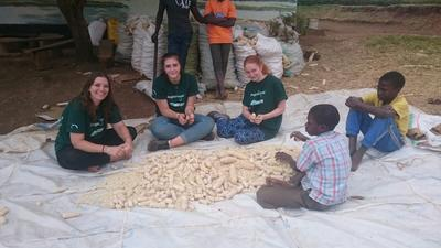 Assisting with harvesting food at an orpahange in Tanzania