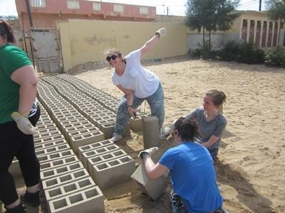 Volunteers building a classroom for the children in Senegal
