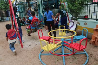 Children playing on the newly painted playground