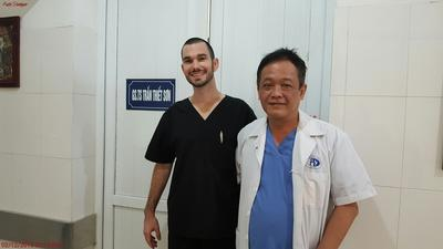 Volunteer with a doctor on the Vietnam medical project