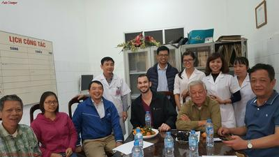 Volunteer with staff at the Vietnam medical placement
