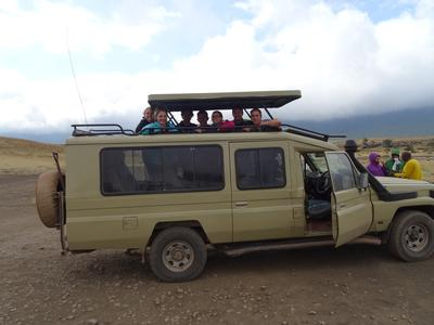 A group of volunteers go on safari together in Tanzania
