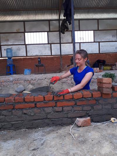 Cecilia laying bricks during her Building Project in Nepal