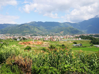 A view of green fields and buildings