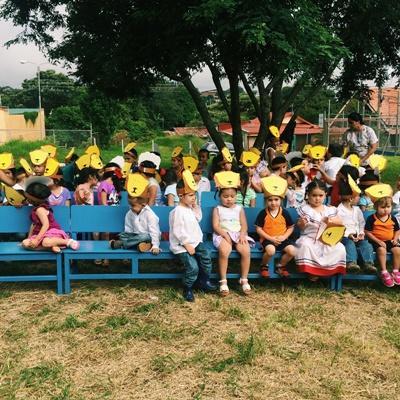 Children wearing handmade lion masks at the daycare centre
