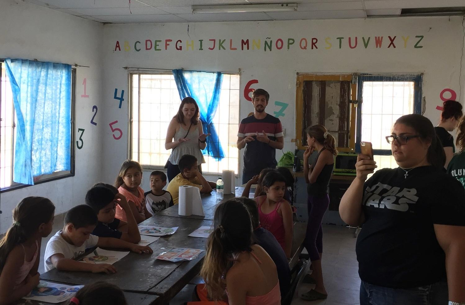 Volunteers teach children about hygiene in Argentina