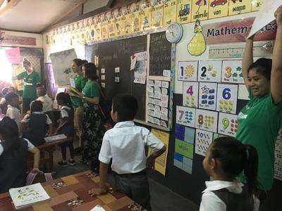 Volunteers teaching children from a local primary school