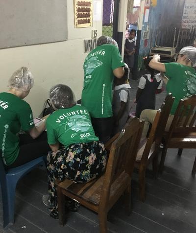 Public Health volunteers doing head lice checks
