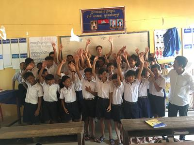 Dylan with the children he taught in Cambodia