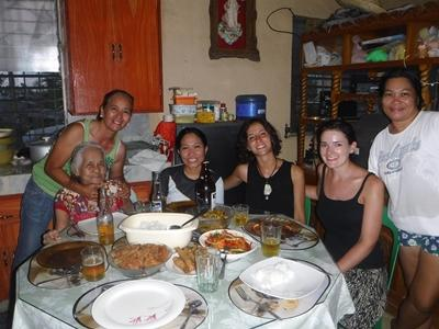 Elaine with her host family in the Philippines