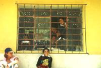 Children through classroom window in Calca