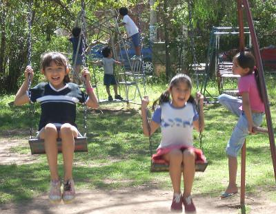 Children on the swings at the orphanage