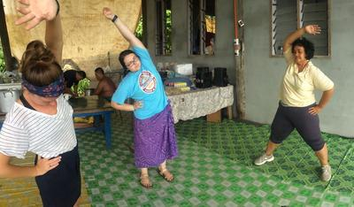Nutrition volunteers doing a workout class with the local woman