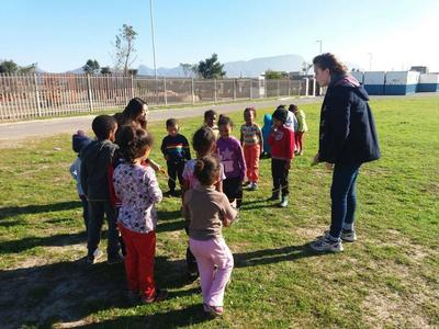 Volunteers working with children at a Care placment