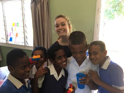 Speech Therapy volunteer Emily with local school children in Fiji