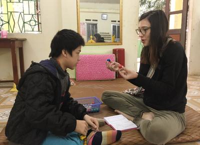 A speech therapy volunteer and child in Vietnam