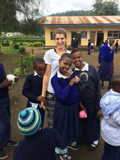 Emily with the children in Tanzania