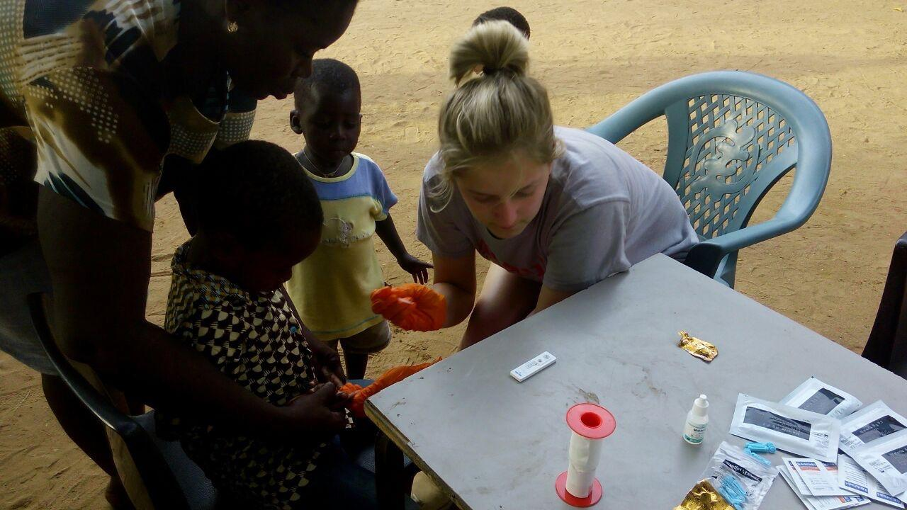 Emily assisting with a medical test in Ghana