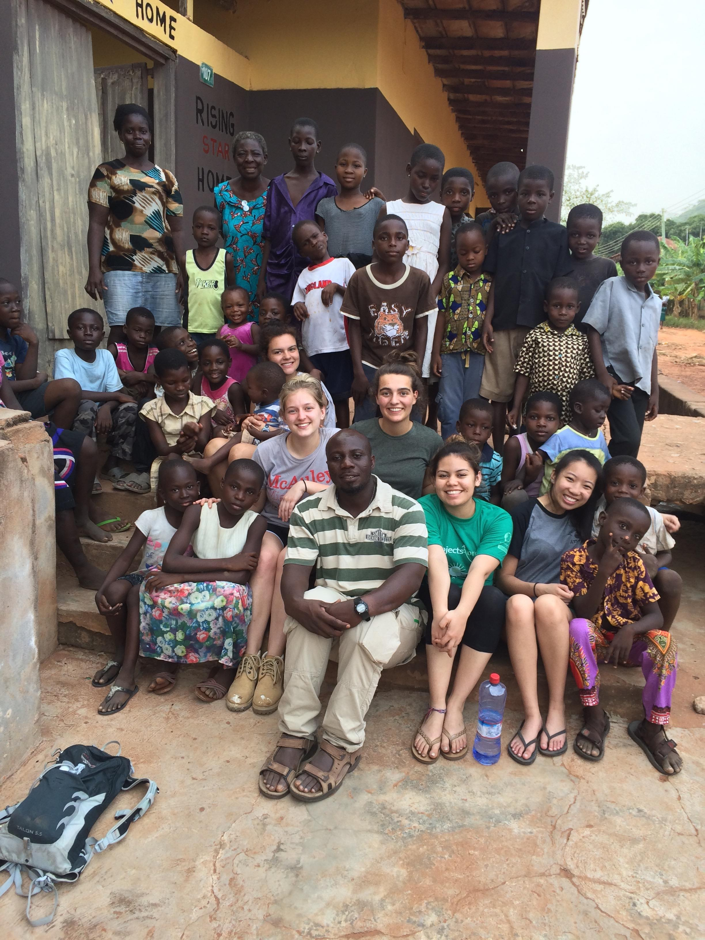 Volunteers posing for a photograph with some Ghanaian locals