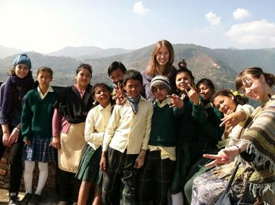 Volunteers with children in Nepal
