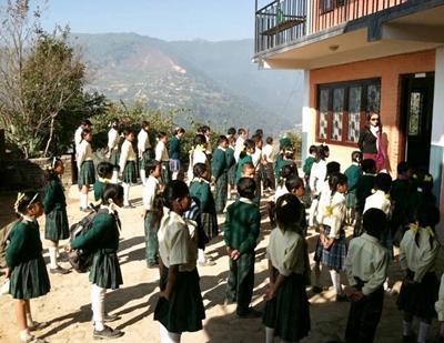 Volunteer teaching at a school in Nepal