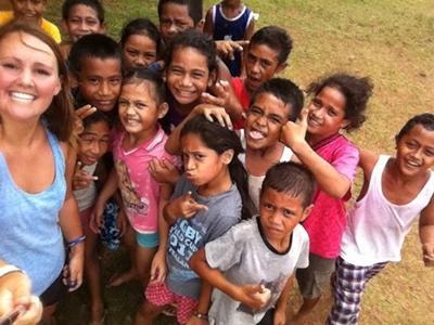 Volunteer with children at school