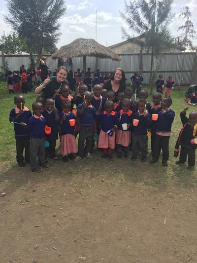 Volunteers teach children about dental hygiene