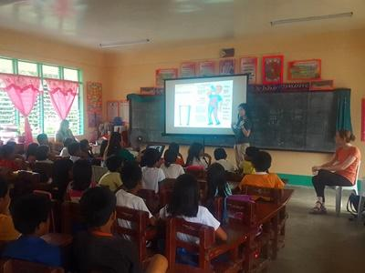 Volunteers doing a presentation on health at a local school