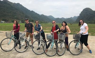 A group of volunteers posing with their bicycles